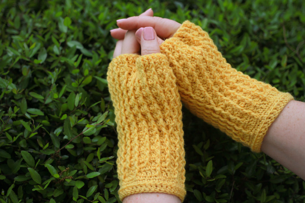 Woman wearing yellow fingerless mitts: Rails Mitts