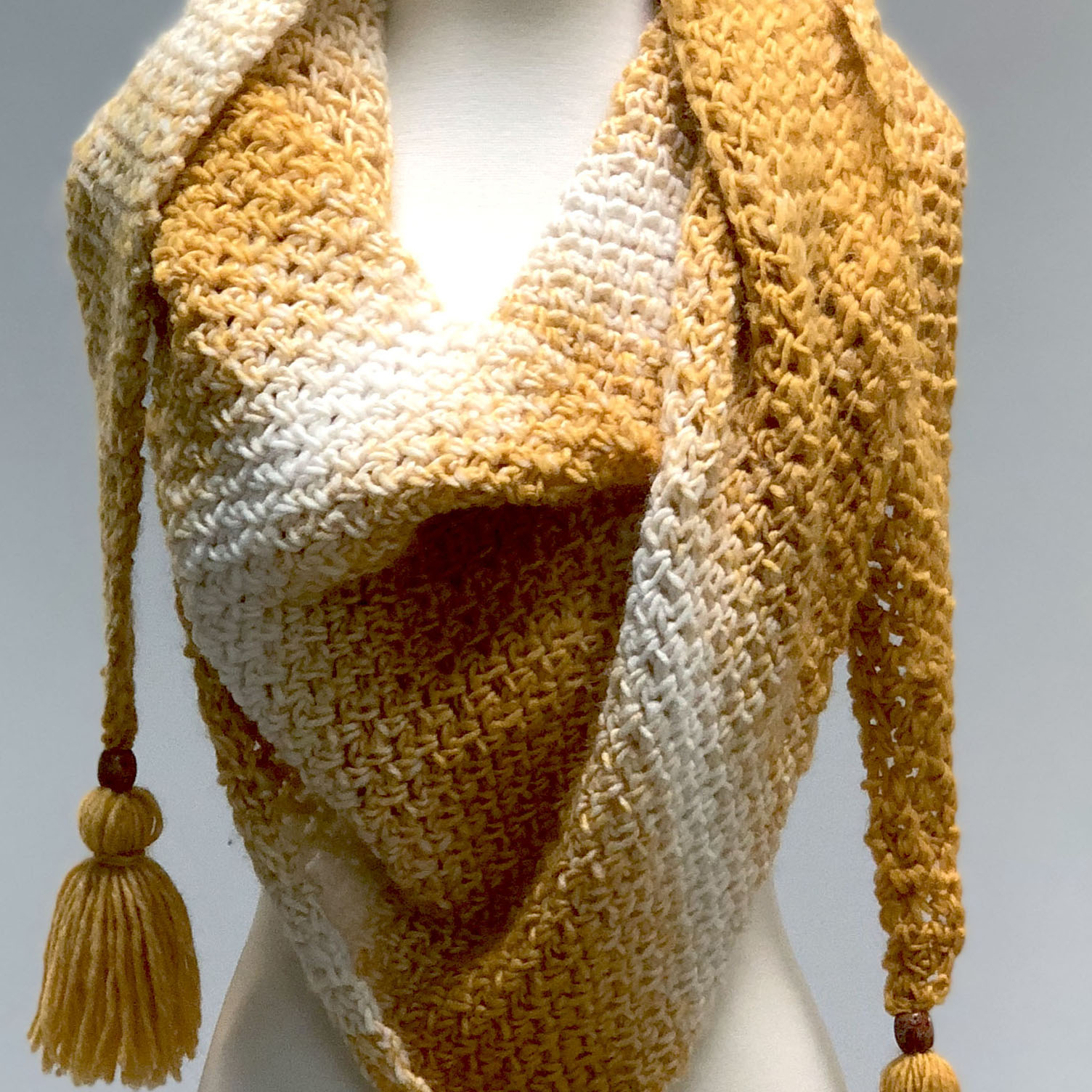 Haystacks crochet shawl in yellow and white on dress form