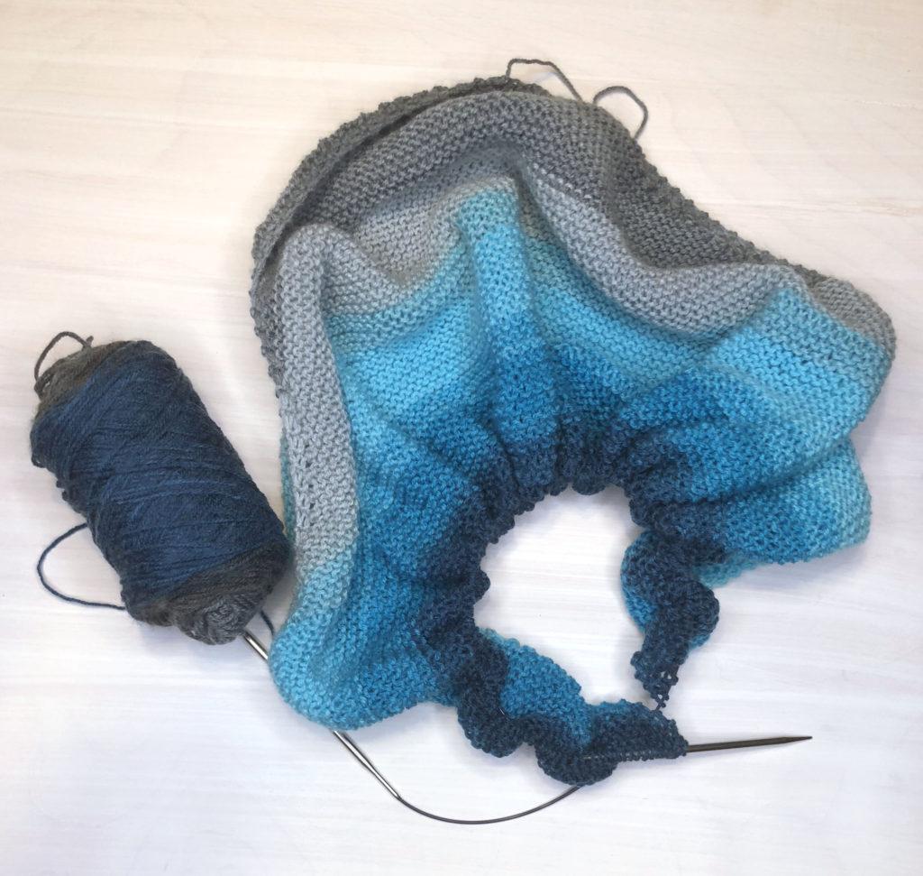 blue grey shawl with mandala lion brand yarn on circular kitting needles