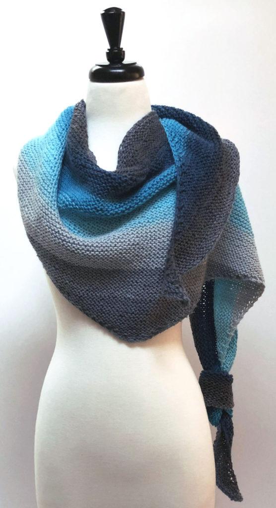 Blue grey knit shawl on dress form